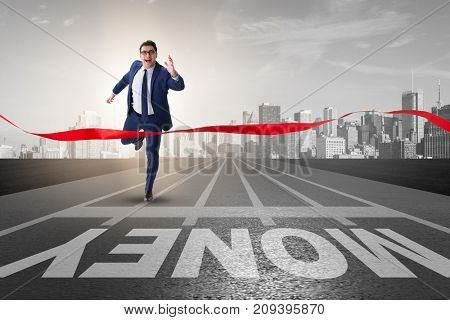 Young businessman chasing money in financial business concept
