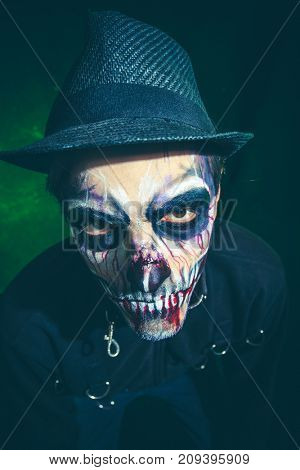 scary halloween skeleton man in jacket and hat studio shot closeup