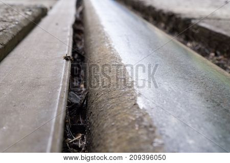 train or tram rail close up with perspective. metal background.