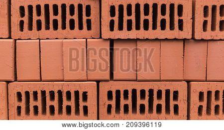 orange clay brick stack pile. texture background.