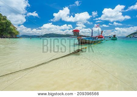 Boats Off The Coast Of Phuket, Clear Water And White Sand