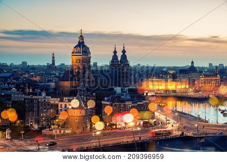 Amsterdam skyline in historical area at night Netherlands. Ariel view of Amsterdam Netherlands.