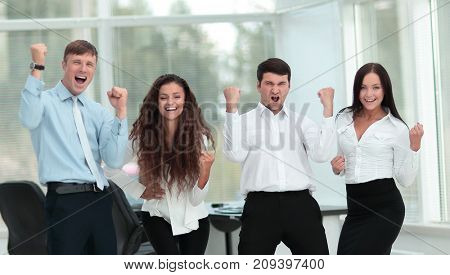 Successful and confident business team celebrating win