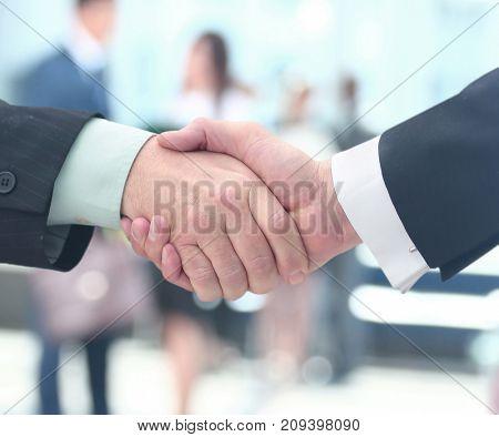 Concept of partnership - handshake  business partners