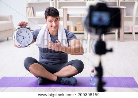 Sports and health blogger recording video in sport concept