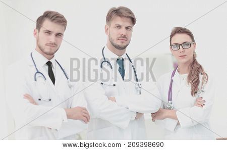 Portrait of a group of friendly  doctors smiling.