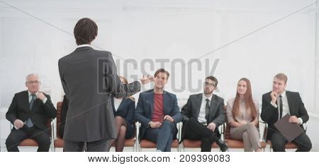 Employees carefully listening to your boss at a business meeting
