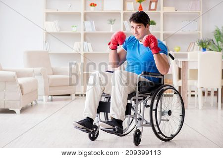 Disabled boxer at wheelchair recovering from injury