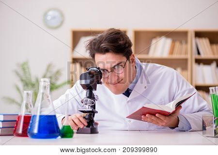 Mad crazy scientist doctor doing experiments in a laboratory