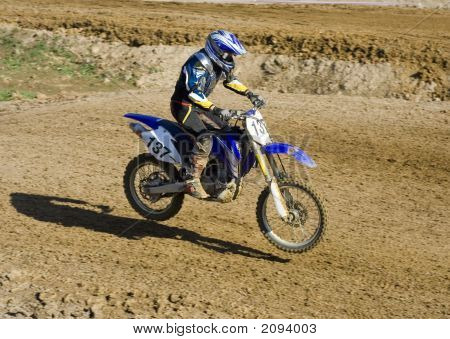 Rider Flying Over Land