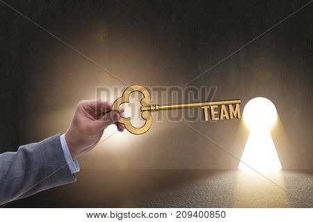 Businessman with key in teamwork concept