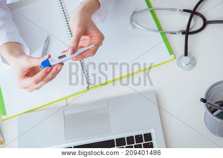 Doctor hand holding temperature thermometer