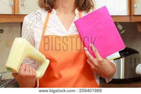 Housekeeper With Cookbook And Mixer