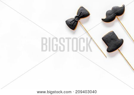 Happy father's day morning with black tie, mustache and hat cookies on sticks for celebrate on white background top view mock up