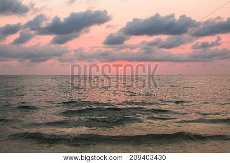 Leaden sunset in cloudly sky Aegean sea.