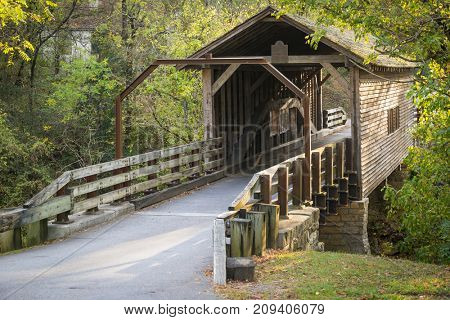 Simple historic covered bridge in warm sunset light