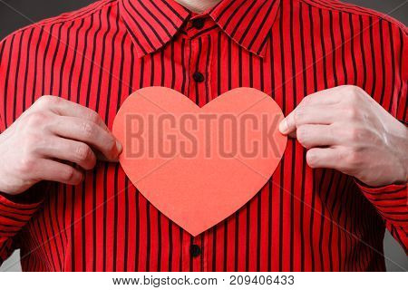 Man Hands Holding Heart Made Of Paper