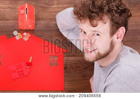 Smiling Man With Property Symbols.