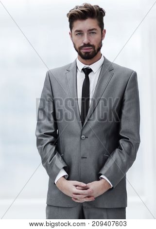 A young man in a gray suit