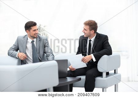 employees talking, sitting the lobby of the office