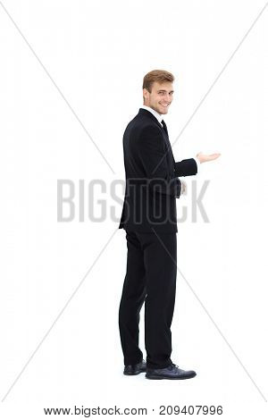 rear view.smiling businessman pointing forward. photo in full growth.