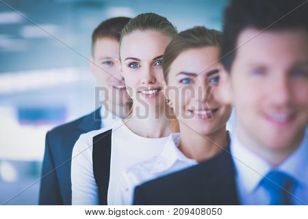 Young businesspeople standing in modern office lobby