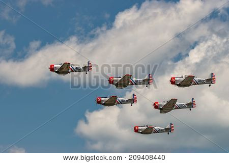 NEW WINDSOR NY - JULY 2 2017: The GEICO Skytypers Air Show Team perform at the New York Airshow at Stewart Int Airport. SNJ-2 World War II era planes fly in formation.