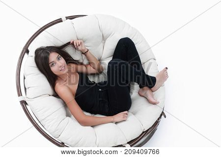 young woman resting in big comfortable armchair