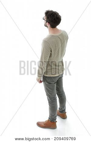 modern young man looks confidently forward. Photo in full length