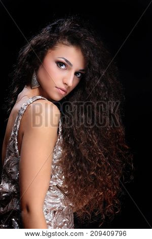 Beautiful woman face close-up portrait of a young studio on blac