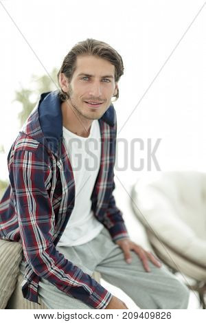 portrait of a successful guy in a checked shirt.