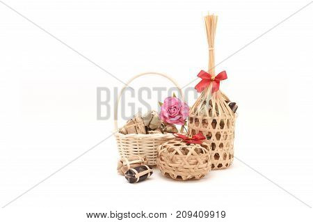 Thai traditional dessert in wicker bamboo basket On white background.