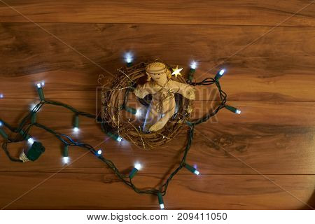 Angel in wreath with Christmas lights for the holidays