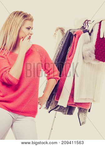 Woman In Winter Wardrobe Deciding What Wear