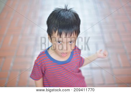 Portrait of cute Asian kid smiling isolated
