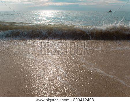 Splash Of Sea Wave On Sand