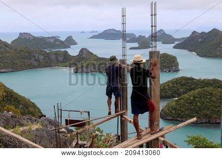 Workers are building on a top of the mountain on the island in Thailand. October 22 2016