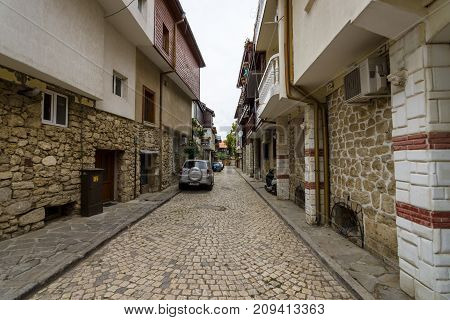 NESEBAR BULGARIA - AUGUST 21 2017: Typical houses and narrow streets in the UNESCO World Heritage town of Nesebar. Nesebar is an ancient city and one of the major seaside resorts on the Bulgarian Black Sea Coast.