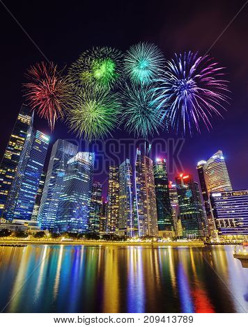 Firework Over Central Business District Building Of Singapore City At Night
