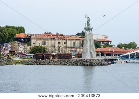 NESEBAR BULGARIA - AUGUST 21 2017: View of the old town the seaport and the monument to St. Nicholas. Nesebar is an ancient city and one of the major seaside resorts on the Bulgarian Black Sea Coast.