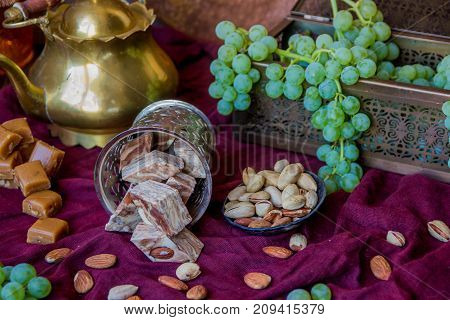 Traditional Oriental Sweets, Nuts And Grape. Metal And Copper Kitchen Tools