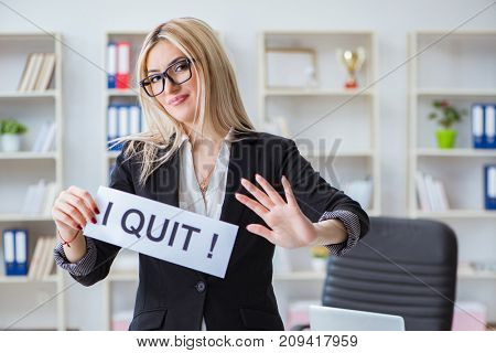 Young businesswoman with message in the office