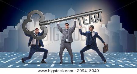 Businessmen holding giant key in team concept