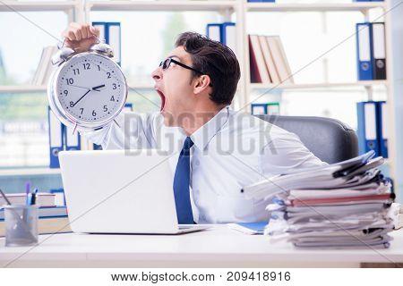 Businessman missing deadline for deliverables in office