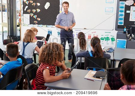 Teacher standing in front of elementary school class