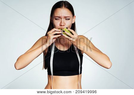 a young dissatisfied girl wants to lose weight and eats Peking cabbage