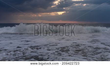 Landscape: Easy storm at sea. Waves and clouds.