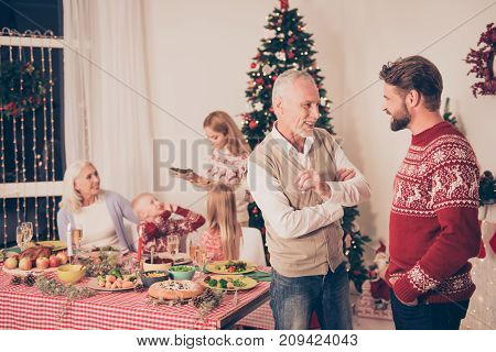Six Cheerful Relatives, Focus Of Old Aged Senior Man And His Son Chatting, Behind Them Are Siblings,