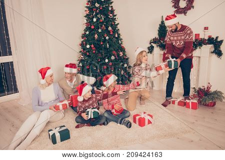 Six Cheerful Relatives Bonding On Carpet At Home, Couple, Excited Siblings, Grandad, Granny, In Knit