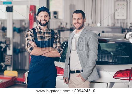 Closeup Of Two Attractive Guys, Cheerful Specialist Repairman In Blue Overall, Businessman In Formal